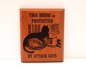 This House is Protected by Attack Cats Vintage 1970s Carol Lebeaux Wood Warning Sign Kitty 1978 Wooden Wall Plaque Cat Lover Gift Funny Cute