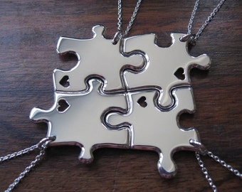 Four Silver Puzzle Pendants with Hearts
