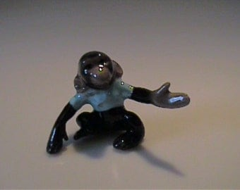 Vintage miniature Hagen Renaker Chimpanzee money with blue shirt