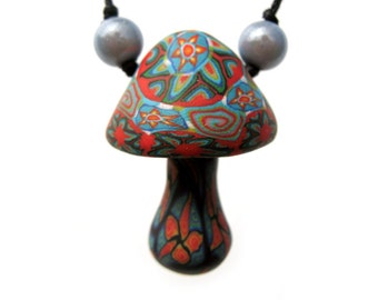 Mushroom pendant, millefiori tribal patterns with starburst design and spirals, handmade from polymer clay, one of a kind, adjustable cord