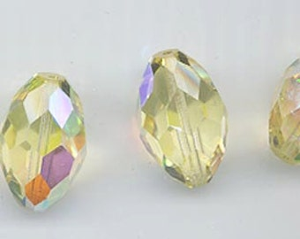 Three vintage Swarovski crystal beads of uncommon beauty and rarity: Art. 46 - 12 x 18 mm - jonquil  aurore boreale