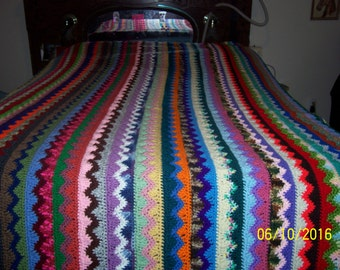 Multi-colored queen size crochet afghan