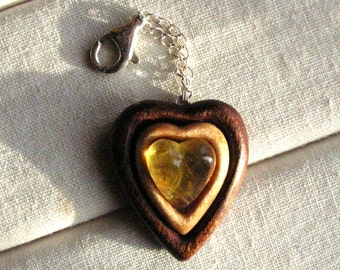 Unique charm Hand carved wooden heart with natural baltic amber Sterling silver clasp