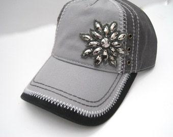 Two Tone Light Grey and Black Trucker Baseball Cap Hat with a Gunmetal Rhinestone Flower Embellishment