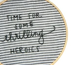 time for some thrilling heroics embroidery hoop wall art