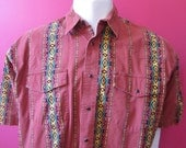 Mens XL cowboy shirt, Wrangler, vintage, short sleeve, rust with green and yellow African or Navajo style pattern, pearl snaps (647)