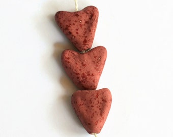 Heart beads,  Ceramic heart beads, ceramic hearts, dark pink hearts, clay hearts, organic heart shaped beads, beads made in South Africa