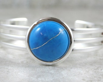 Kintsugi (kintsukuroi) cuff bracelet with turquoise dyed howlite stone cabochon with silver repair in a silver plated setting - OOAK