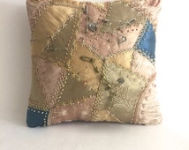 Antique handmade quilted embroidered pincushion