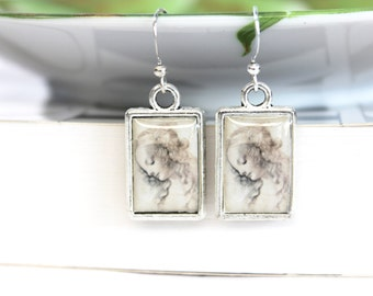 Art resin earrings double sided with Da Vinci illustrations