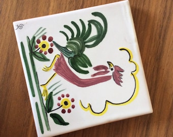 Handpainted ceramic tile with fantasy motif.