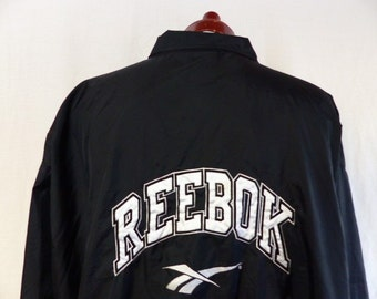 vintage 90s Reebok black full front zip windbreaker track jacket black embroidered white applique back front logo nylon training warm up XXL
