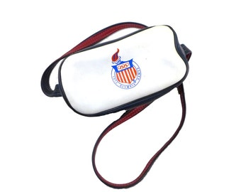 Kodak brand OLYMPICS crossbody camera case - naugahide, faux leather / red white and blue, zip front, bag / handbag