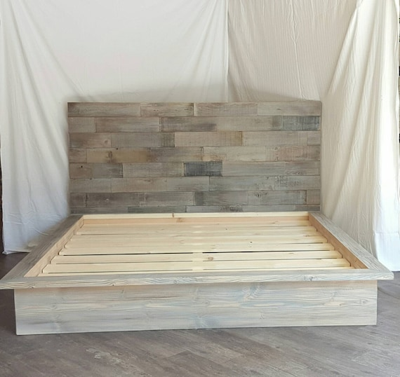Steph grey driftwood finished platform bed with horizontal staggered patched recycled reclaimed wood headboard