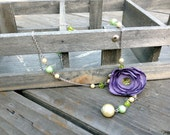 Green Beaded Necklace with Purple Fabric Flower