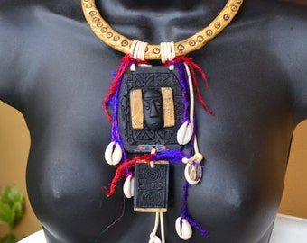 Worn to be Wild, a Handmade polymer clay, faux ivory/bone tribal necklace, from a UK shop