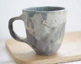 A smooth ceramic mug, 6 oz. , handmade ceramic mug