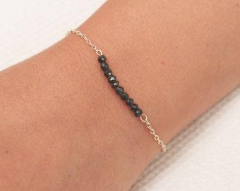 Dainty Gold Gemstone Bar Bracelet Tiny Black Bead Bar Bracelet Delicate layered gold filled bracelet .