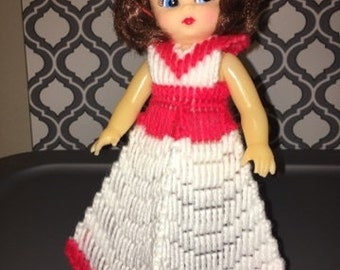 Red plastic canvas doll