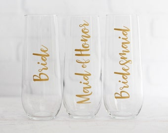 personalized champagne flutes // bridesmaid champagne glasses  // bridesmaid proposal gifts // bridesmaid gifts // mom of the bride gift