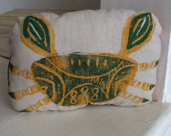 Hand printed lino crab pebble pillow