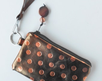 Metallic leather coin purse/key ring.   Copper polka dotted leather wristlet.