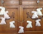 Sweet pink and creamy white garland swag of Easter bunny rabbits with French writing
