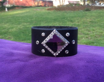 Women's Black Leather Cuff with a Purple Crystal Concho and Rhinestones