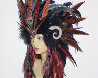 Custom black, red, orange feather headdress with tiger medallion and sculpted ram inspired horns