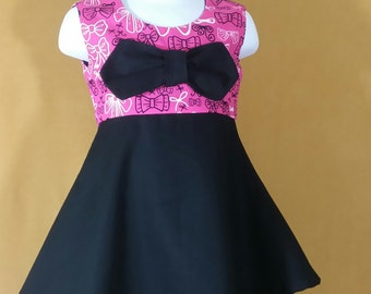 Pink and black dress with double skirts