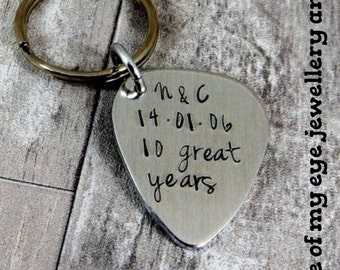 Hand stamped single guitar pick key ring, personalised with a message of your choice.