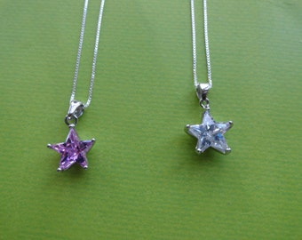 Star sterling silver pink .blue or clear crystal pendants