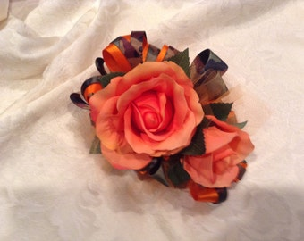 Corsage in orange and camo