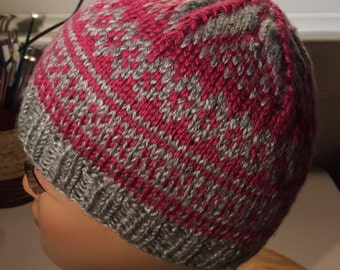 Knitted pink and gray beanie hat