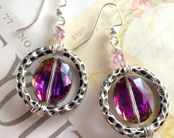 Wire wrapped artisan earrings with pink Swarovski crystal.