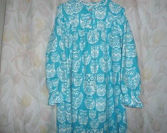 Ladies Small Gown with white owls on turquoise back ground.