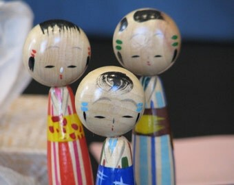 1950's dime store Japanese kokeshi doll set.