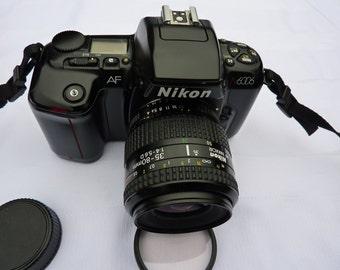 Nikon AF N 6006 w/ Nikon AF Nikkor, 35-80 mm 1:4-5.6D lens, Nikon shoulder  strap,  Vintage.