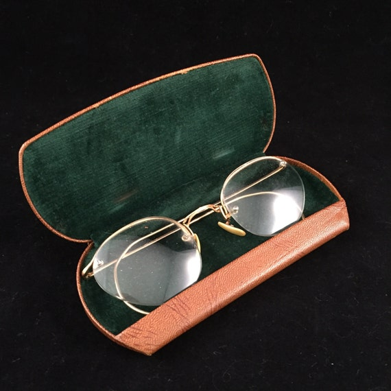 set of antique wire frame eye glasses with rustic