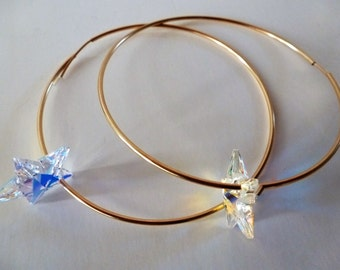 Catch A Falling Star Endless Hoops; big and gold, snag dimensional Swarovski crystal stars to orbit, throwing sparks.