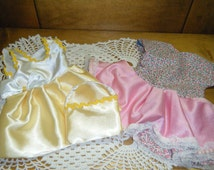 HANDMADE  DOLL CLOTHES to fit  American Girl Journey Girl. Two Party dresses or Easter Sunday dresses.  Yellow with bow and Pink  and floral