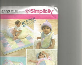 Simplicity pattern.  BABY ACCESSORIES by Shirley Botsford Designs..Quilt , pillow cover, wra[,bib, bag, hat
