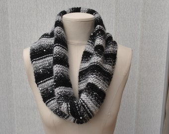 Hand knitted cowl in black/grey variegated yarn