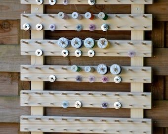wall display for 60 spools and 60 cans