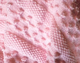 Pretty in pink hand-knit baby blanket