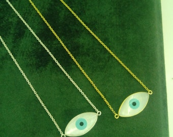 Gold and necklace with mother of pearl evil eye