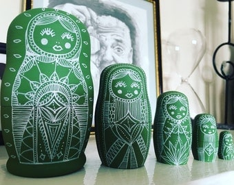 Large green Russian doll set.