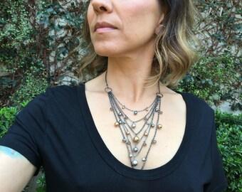 Multi chain necklace gunmetal 6 strands.