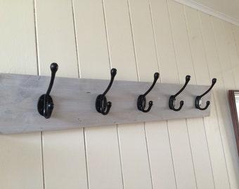 White washed coat hooks