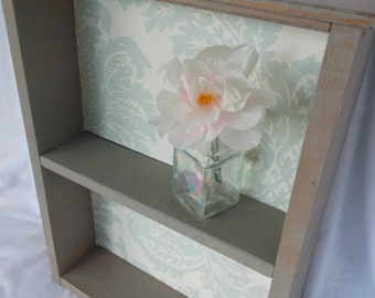 Vintage desk drawer repurposed into a shelf
